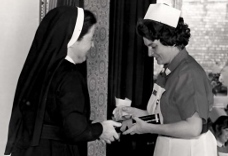 Doreen Pemberton receiving her nursing certificate